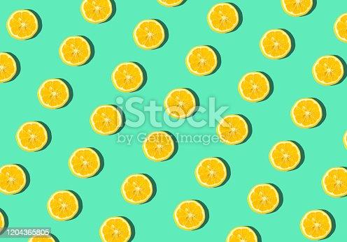 Summer and vitamins background. Lemon on a blue background, minimal food concept.