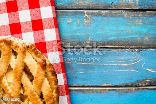 Latice crust apple pie on red gingham napkin