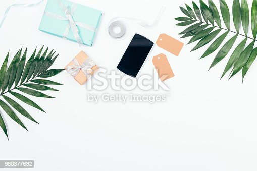 istock Summer arrangement with palm branches, gifts, ribbons 960377682