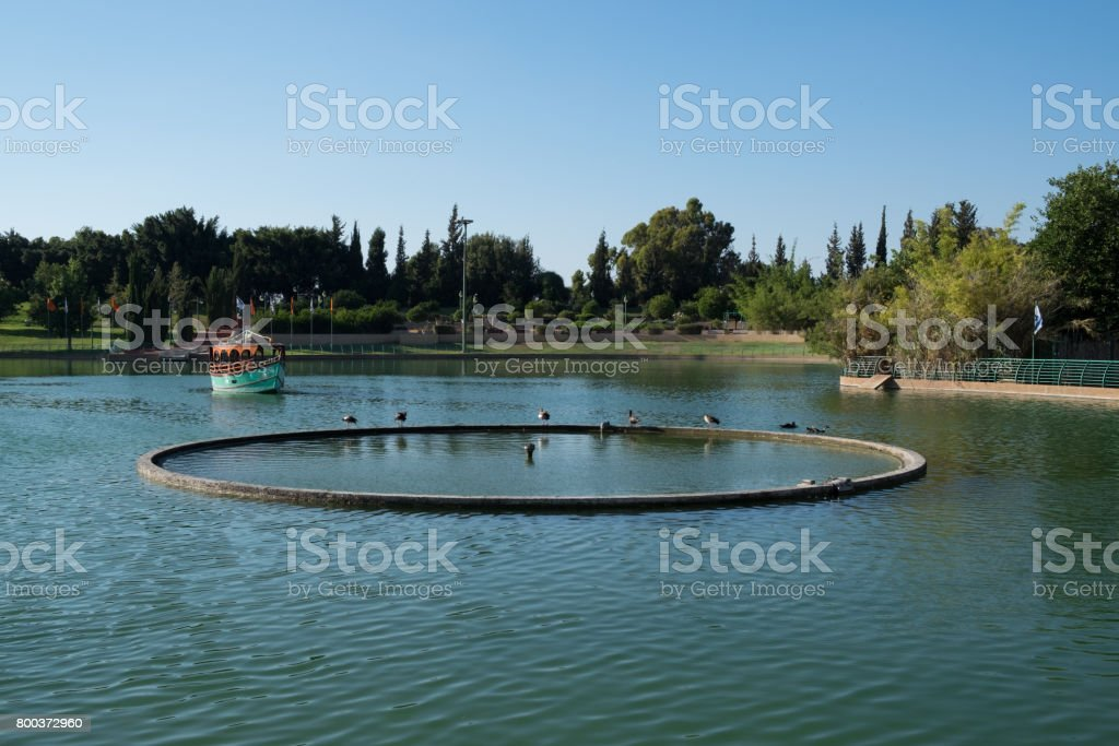 Summer at the Raanana park lake without a cloud in athe aky stock photo