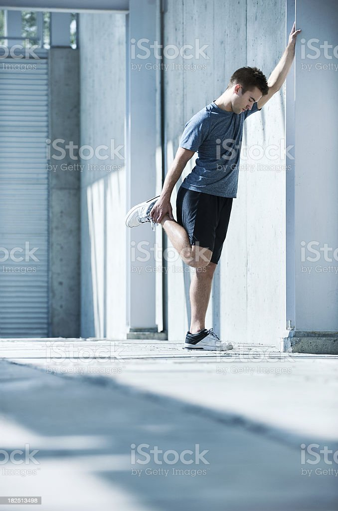 Summer athelete stretching in a modern outdoor uraban royalty-free stock photo