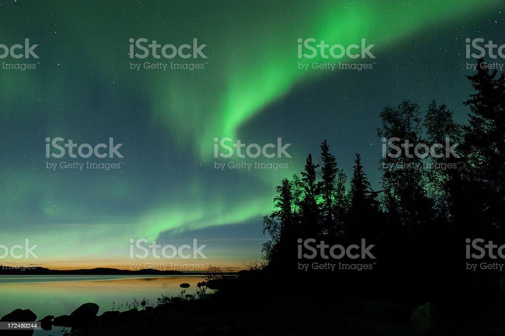 Summer aurora on lake stock photo