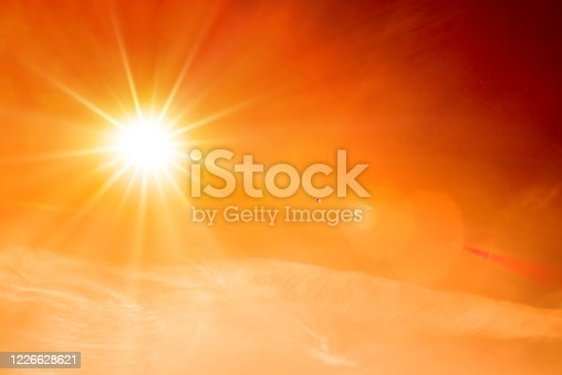 istock Summer background, orange sky with clouds and bright sun 1226628621