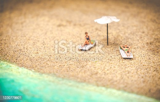 summer background sunbather couple in deserted beach sunbathing with copy space .