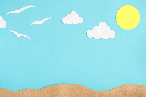 Summer background with  gulls and clouds. Paper cut.