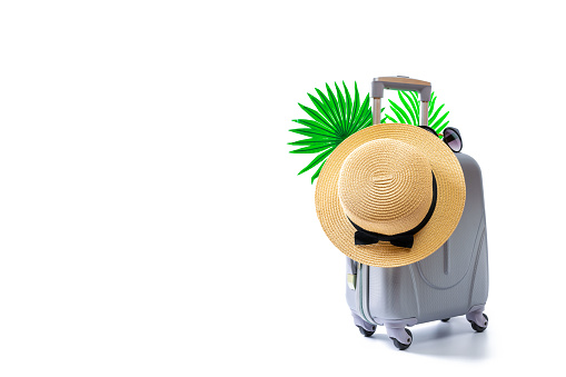 Summer background wood. Womens accessories traveler: suitcase, straw hat, sunglasses isolated on white with empty space for text. Design of summer vacation holiday with copy space