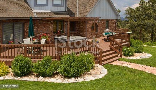 Upscale home & back deck in summer. SEE all SUMMER IMAGES: