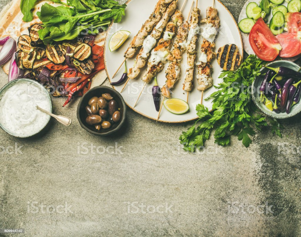 Summer barbecue party dinner set, concrete background, copy space stock photo
