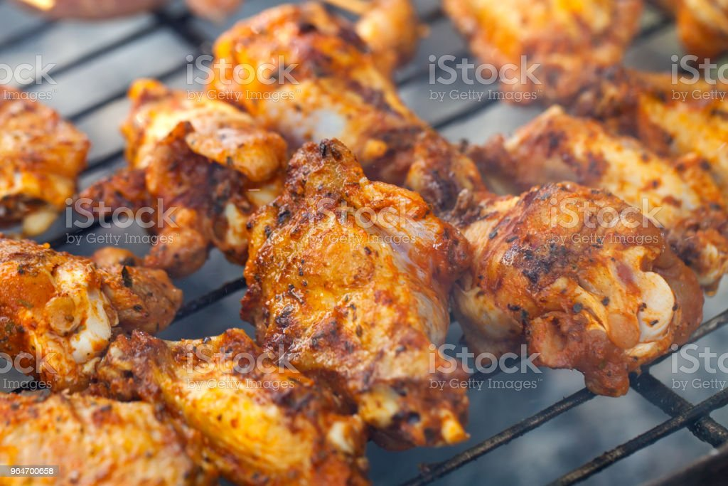 Summer barbeque - grilled chicken wings royalty-free stock photo