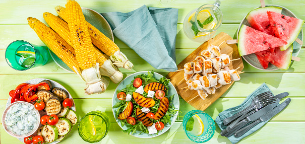 istock Summer bbq party concept - grilled chicken, vegetables, corn, salad, top view 1034954536