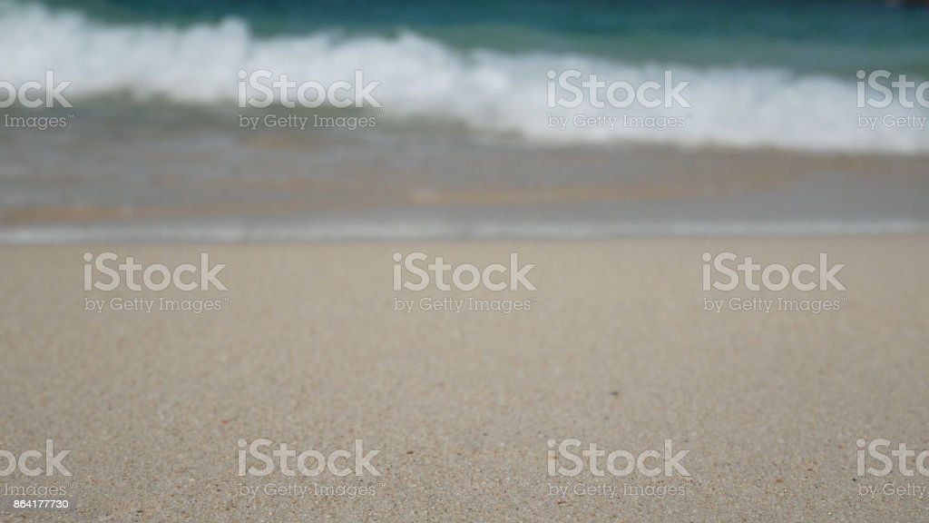 summer beach and sea holiday vacation background wallpaper. white sand beach and clear water with white bubble wave royalty-free stock photo