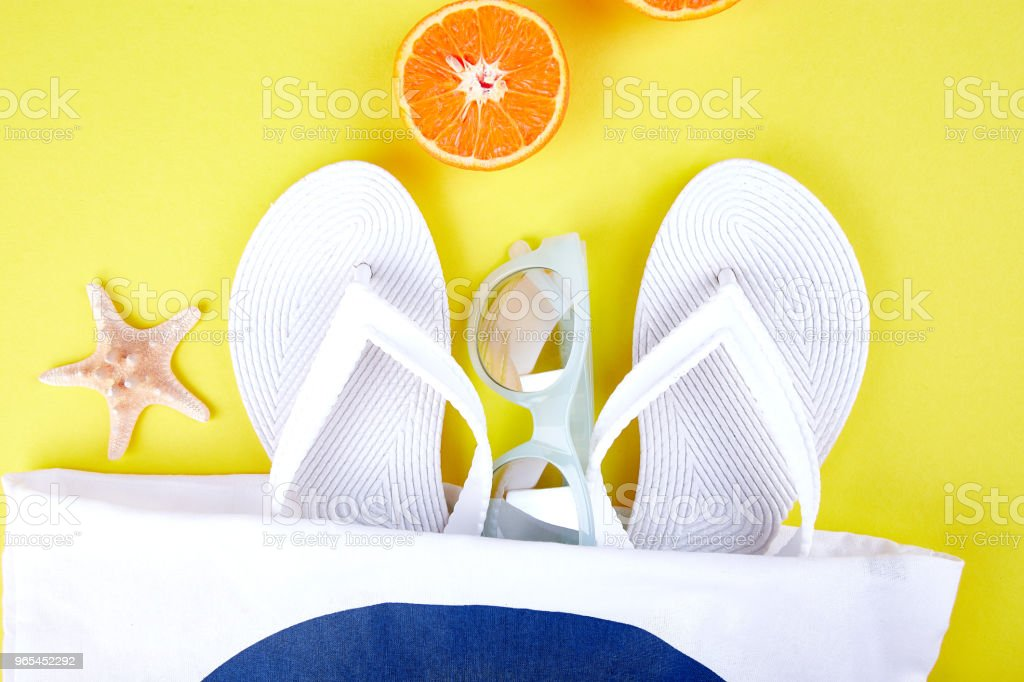 Summer beach bag with flip flops, zbiór zdjęć royalty-free