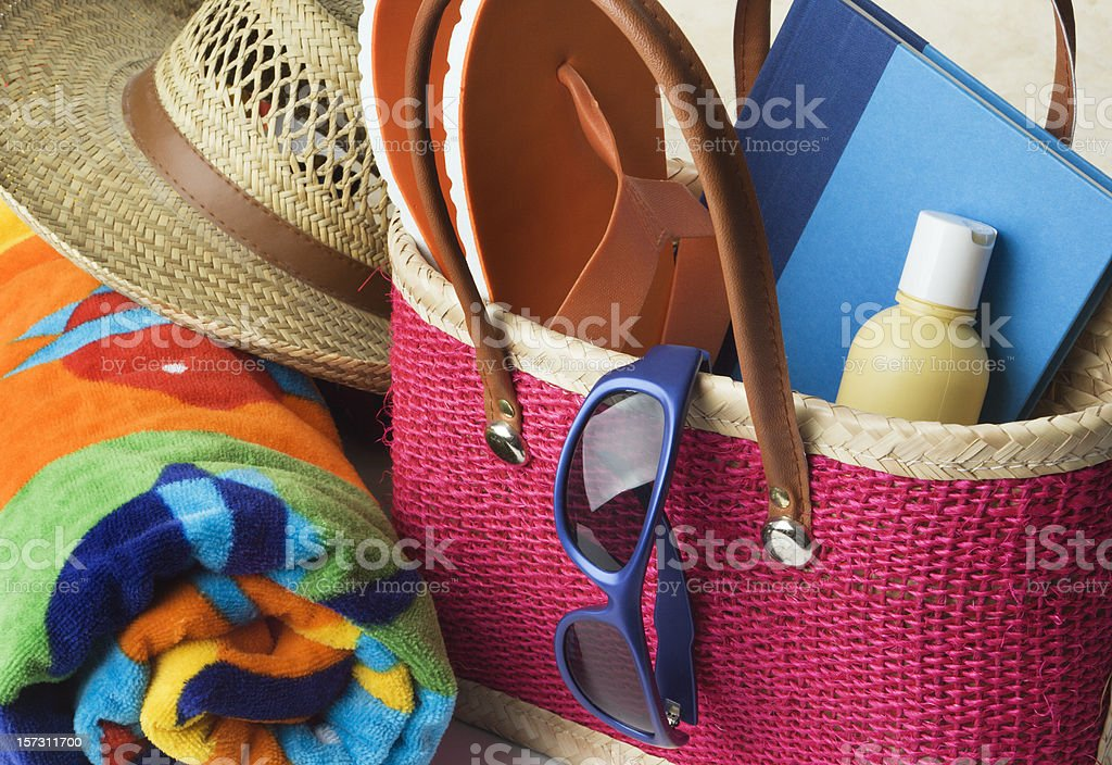 Summer Beach Bag with Suntan Lotion, Towel, Sunglasses, Hat stock photo