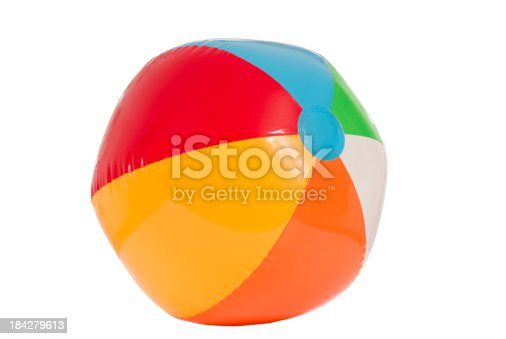 Very colorful and bright beach ball ready to play with.  Isolated on white.  Studio shot.