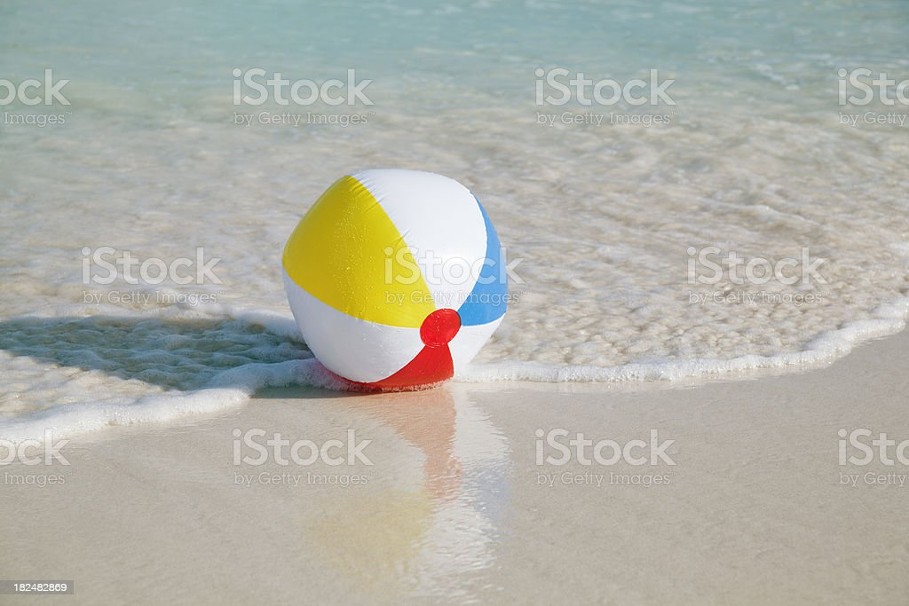 Summer Beach Ball Playing in the Wave royalty-free stock photo