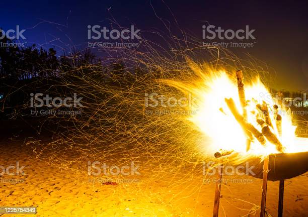 Photo of Summer beach bonfire