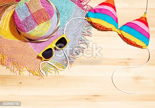 istock Summer beach fashion item.Accessories on the wooden table 533990792