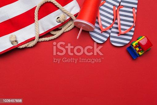 istock Summer beach flip flops on colored background 1026457658