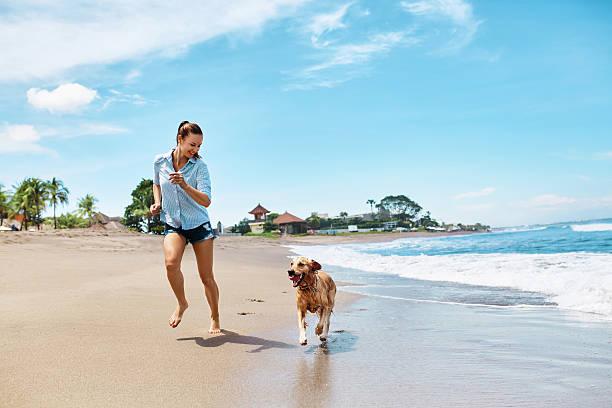 Summer beach fun woman running with dog holidays vacations summer picture id600061100?b=1&k=6&m=600061100&s=612x612&w=0&h=glvoo4bf k2wap9t0cxwqmos2jzwg emweez6kbprla=
