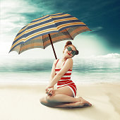 Funny girl on the beach. Vintage like. Digitally generated image.