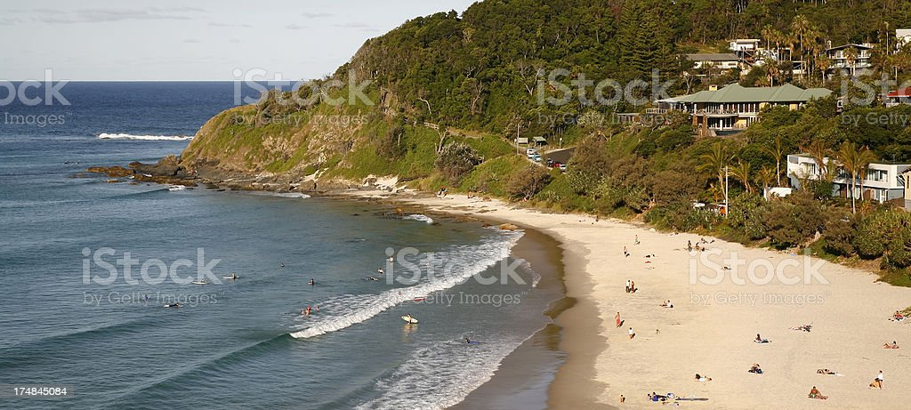 Summer beach panorama with sand, surf and forest royalty-free stock photo