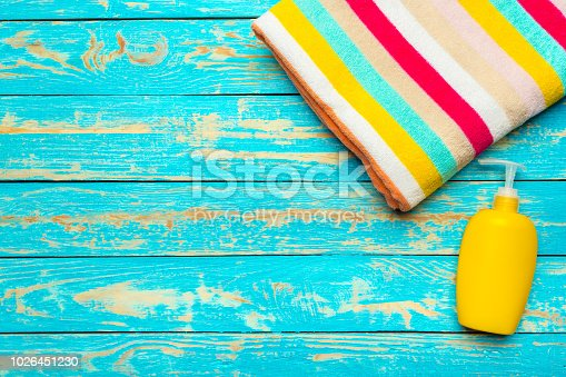 istock Summer beach towel on colored background 1026451230