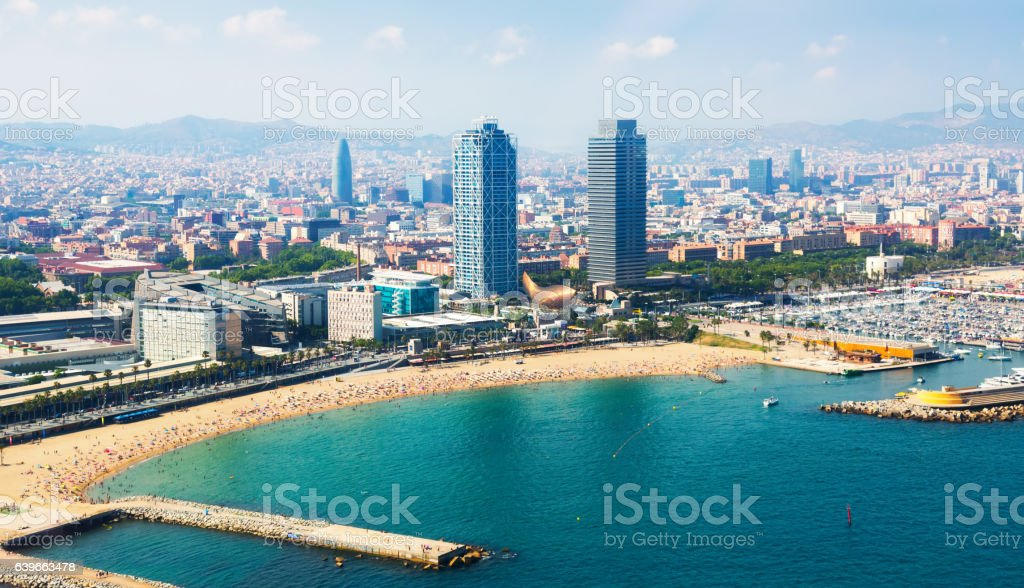 Summer beach with many people resting at Barcelona seaside stock photo