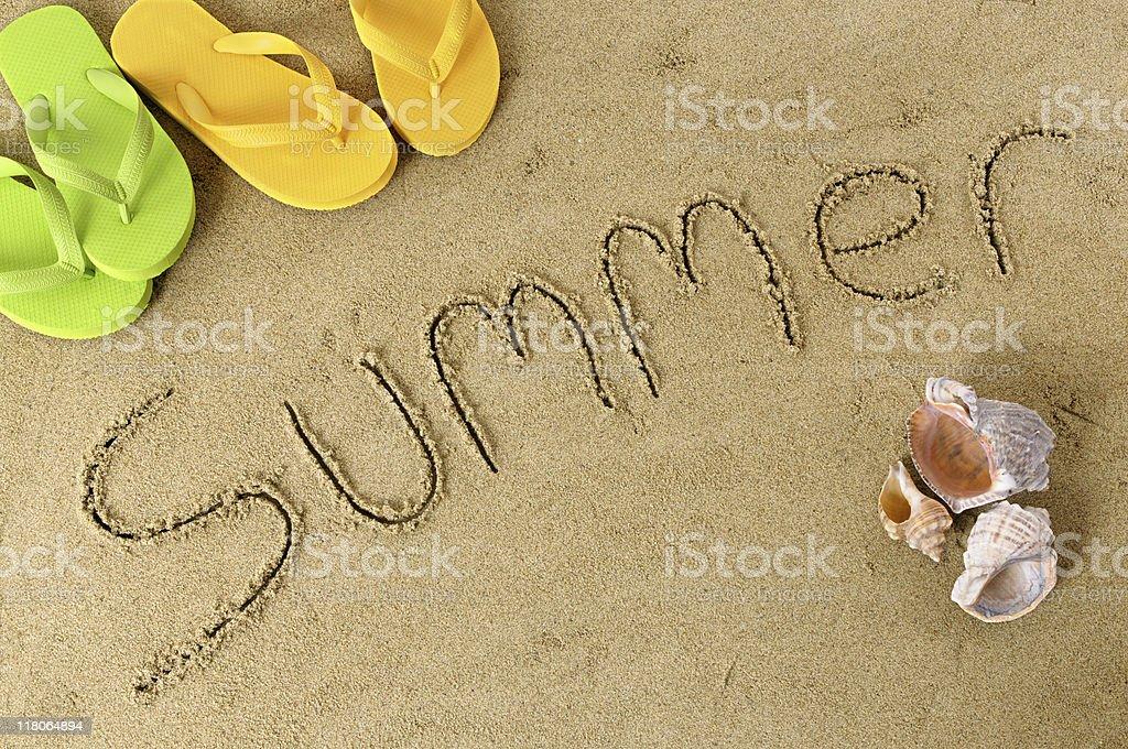 Summer beach writing stock photo