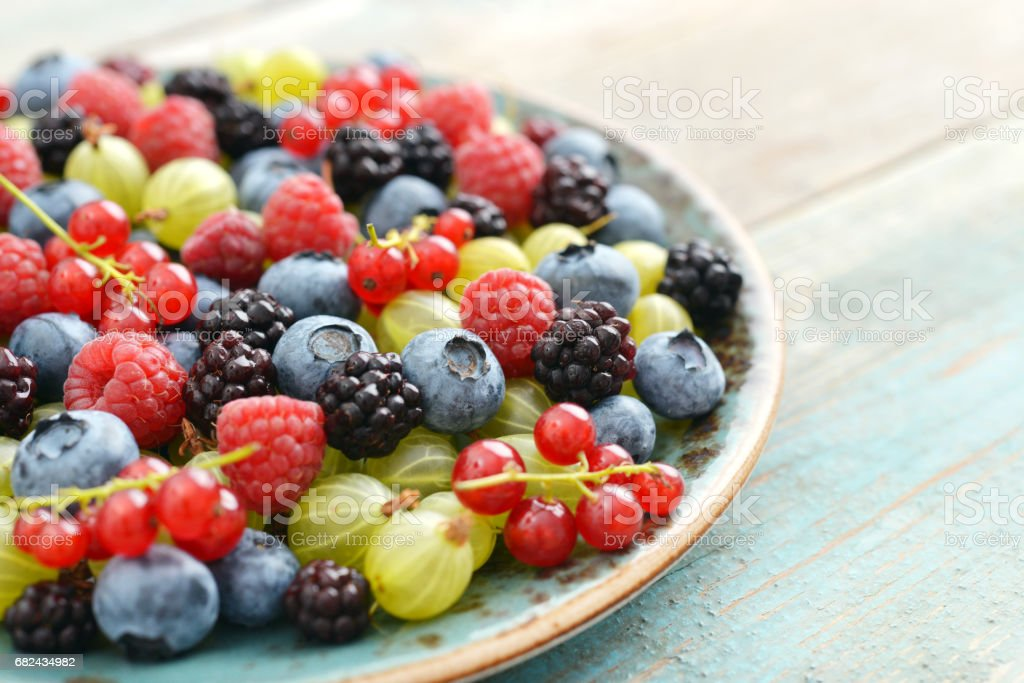 Summer berries on plate royalty-free stock photo