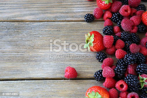 istock Summer berries on wooden background 516914937