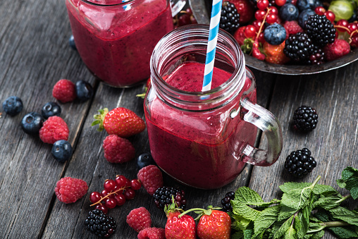 istock Summer berries smoothie in mason jar 484303428