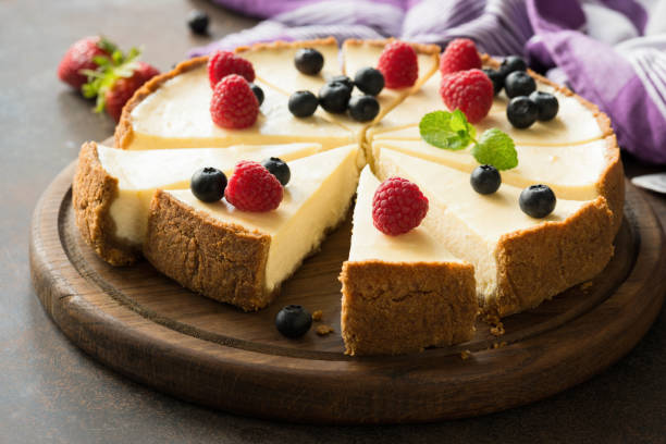 Summer berry cheesecake cut into slices stock photo
