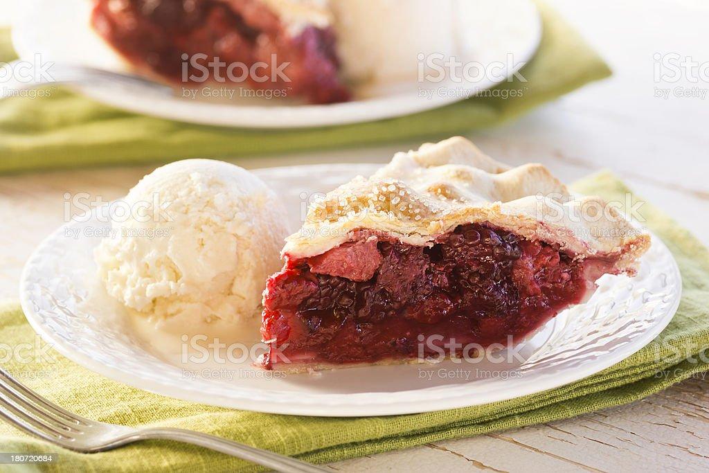 Summer Berry Pie with Vanilla Ice Cream stock photo