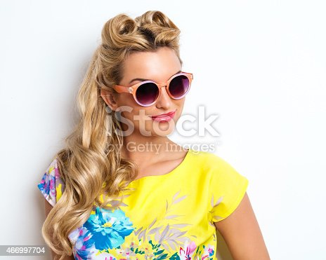 istock Summer Blonde Woman wearing sunglasses 466997704
