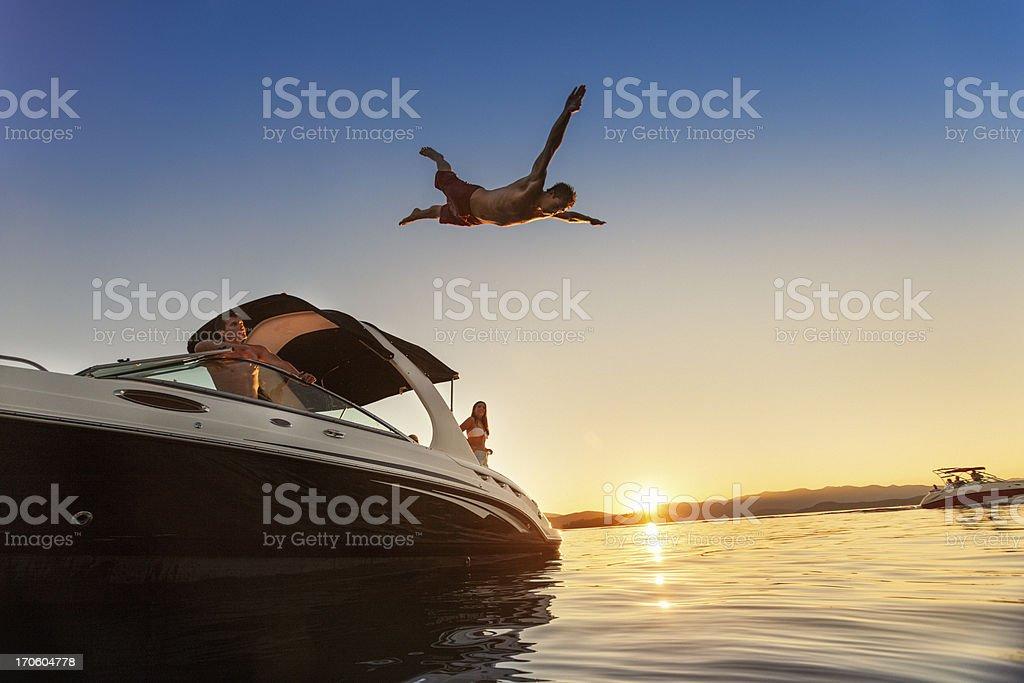 Summer Boating Sunset Jump stock photo