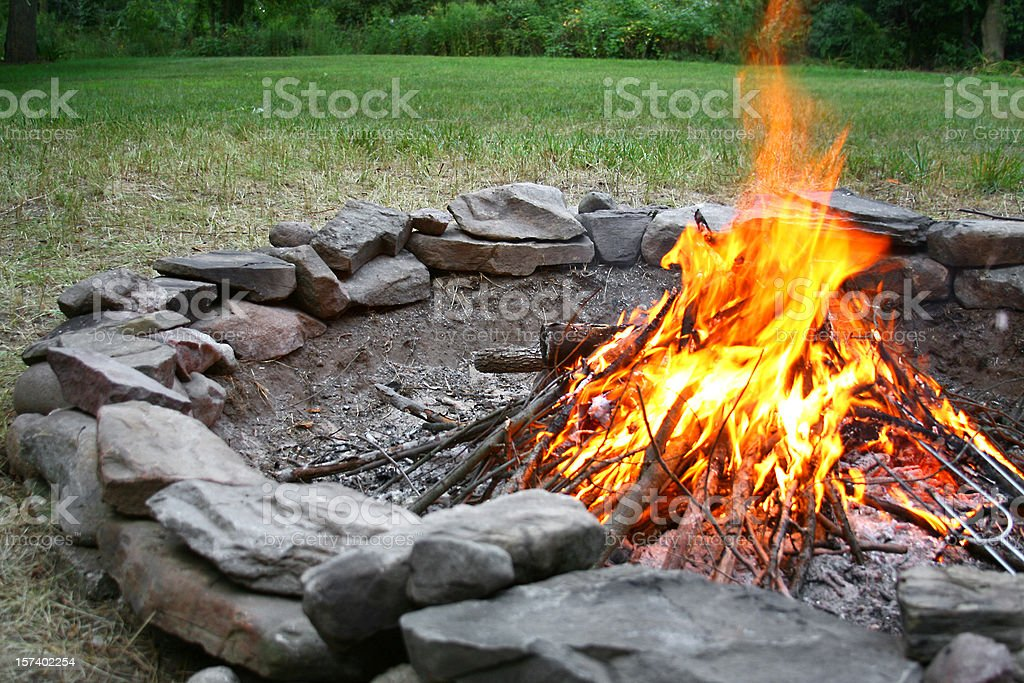 Summer Bonfire in stone fire pit royalty-free stock photo