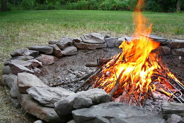 Summer Bonfire in stone fire pit stock photo