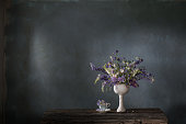 summer bouquet in blue and violet colors on dark background