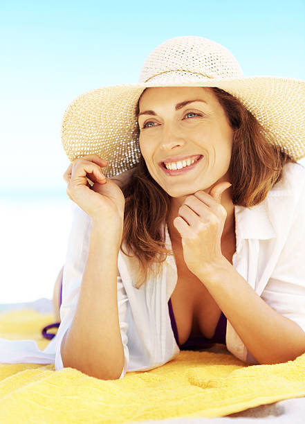 summer brings out the best in me - older women bikini stock pictures, royalty-free photos & images
