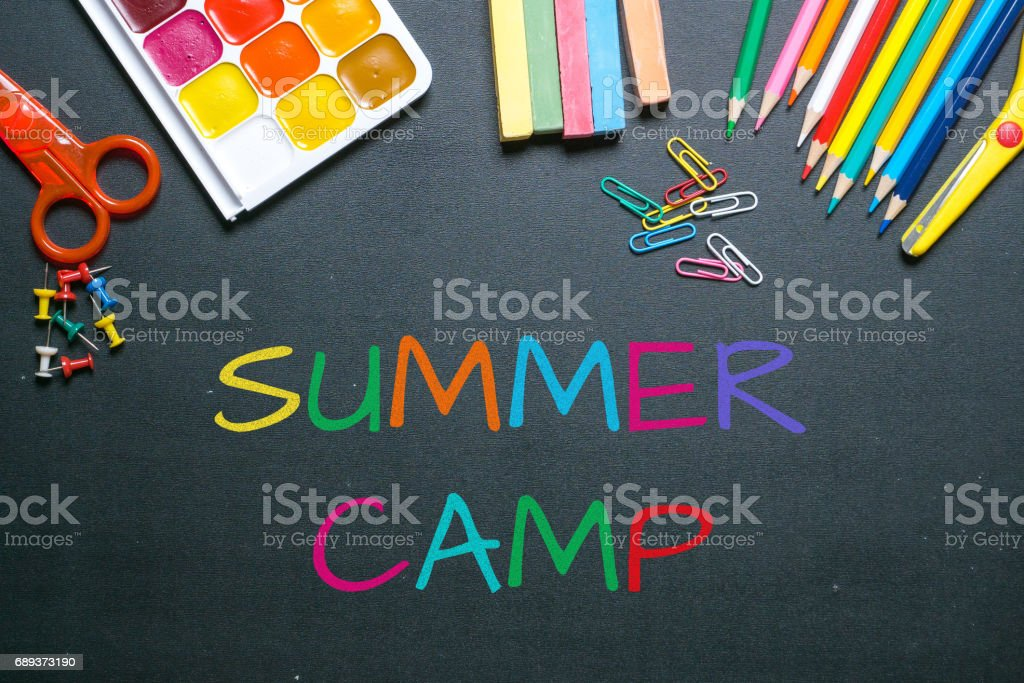 summer camp colorful chalk text on blackboard stock photo
