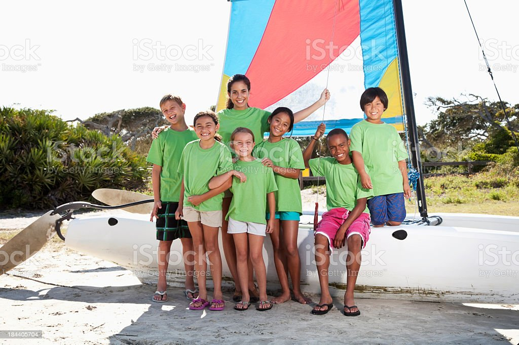 Summer camp counselor and children with catamaran royalty-free stock photo