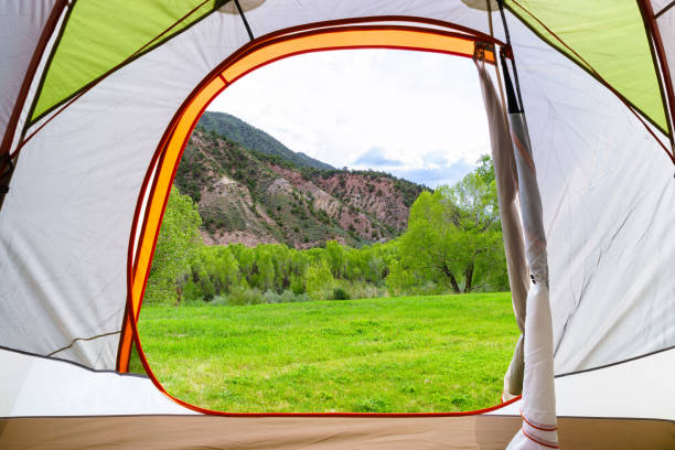 Summer Camping Tent View of Scenic Hills and Mountains stock photo