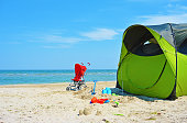 Summer camping with a tent at a lonesome wild beach Lido di Classe, Italia