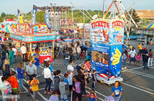 Media, PA, USA – May 17, 2014: People enjoy games, food and rides at a traveling summer fair.