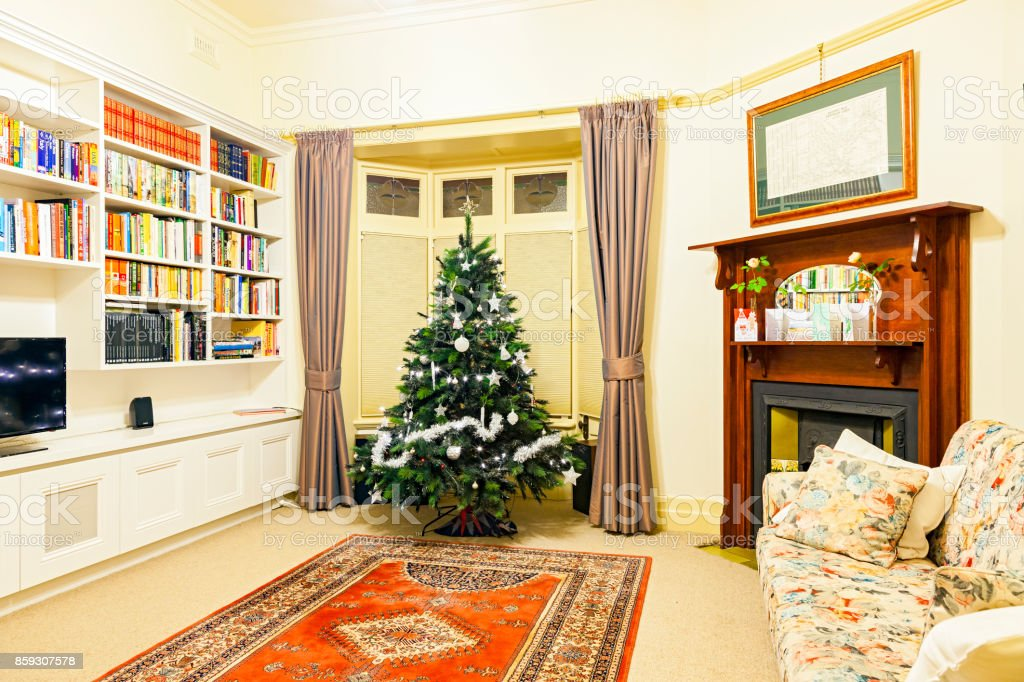 summer christmas home interior cosy library with christmas decorations at night royalty free - Library Christmas Decorations