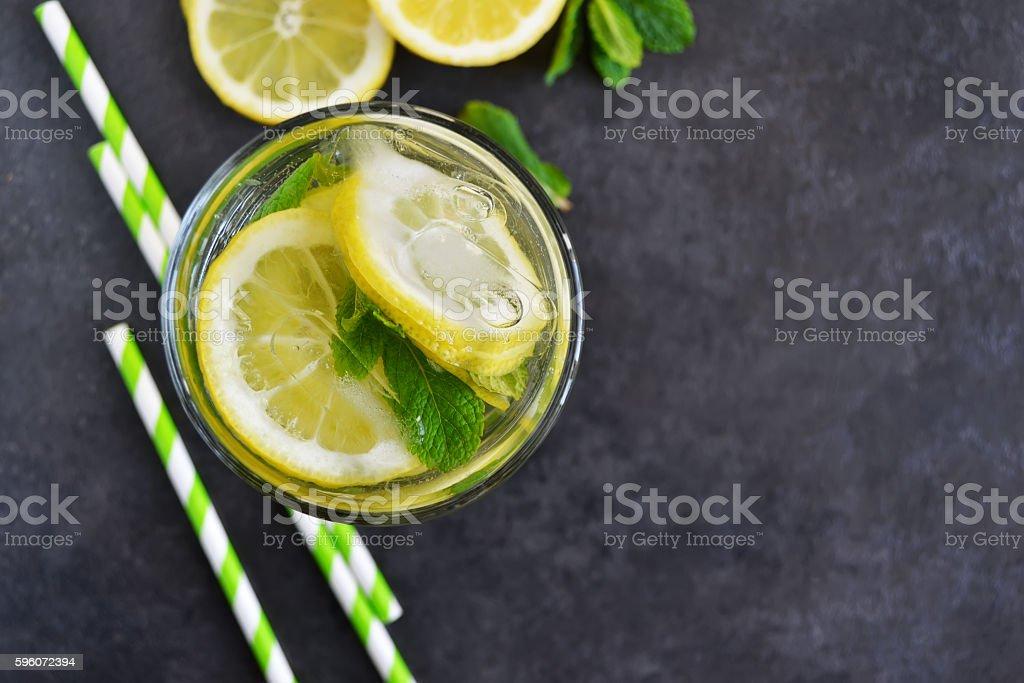 Summer Citrus lemonade with mint on black background royalty-free stock photo