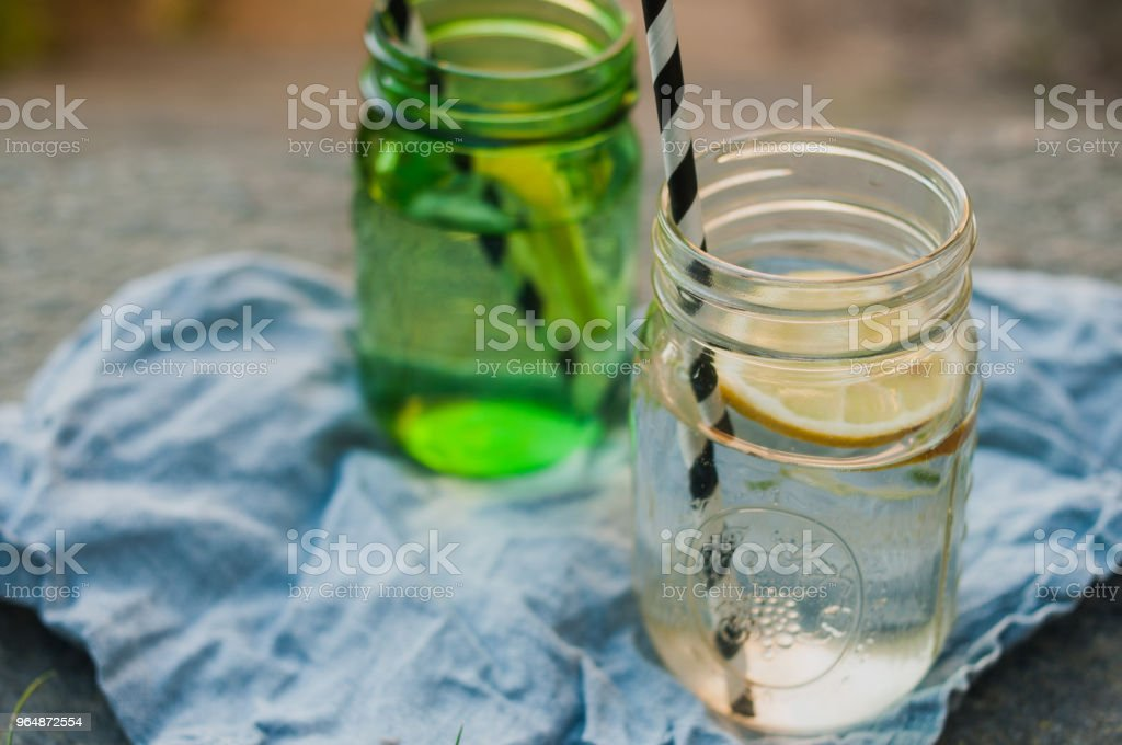 Summer close up shot of two mason jars with lemon and water royalty-free stock photo
