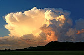 Puffy Cumulus clouds billow up over south Florida on the edge of a growing storm system