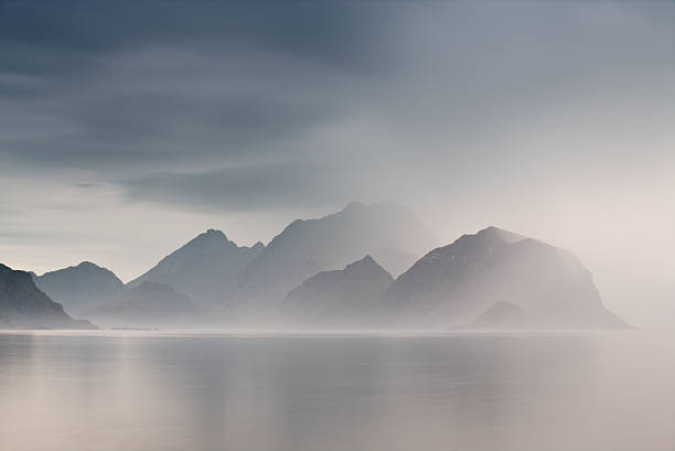 Summer cloudy Lofoten islands. Norway misty fjords. Summer cloudy Lofoten islands. Norway misty sea and fjords. Nordic rain. scandinavian culture stock pictures, royalty-free photos & images