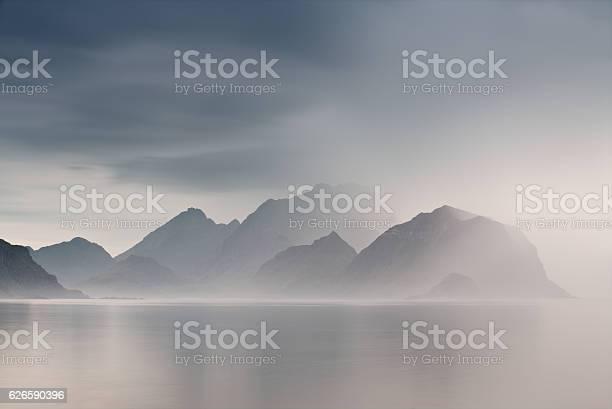 Photo of Summer cloudy Lofoten islands. Norway misty fjords.